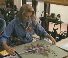 "Grace Kelly measuring one of her flower collages, from ""My Book of Flowers"" (published 1980)"