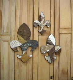 Make a bunch of fleur de lis out of celing tiles and scatter them on the wall like spanish crosses