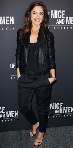 Minka Kelly's look was the very definition of casual cool, topping off a black top and black trousers with a leather moto jacket and a subtle necklace and a delicate pair of ankle strap heels.
