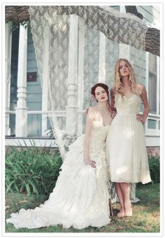 Bride and Bridesmaid picture with lace backdrop.