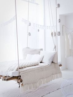 Come on, nobody can resist a giant swinging raft-bed covered in chunky knit blankets