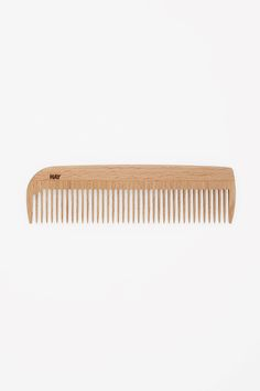 Made from waxed beechwood, this wide-tooth comb is designed to fit into your pocket or bag.