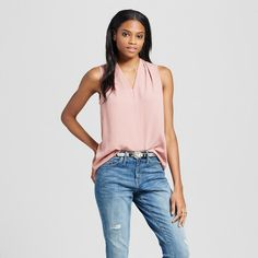 It's basic, can be paired with jacket or sweater or worn alone. Women's Sleeveless V-Neck Blouse