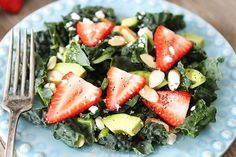 Kale, Strawberry, and Avocado Salad with Lemon Poppy Seed Dressing via Two Peas and Their Pod. (Almonds, avocado and a sprinkling of cheese.