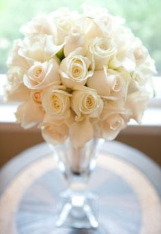 I like the idea of off-white roses for my bouquet