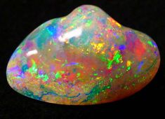 An opalised crystal shell from Coober Pedy mine in Australia. Photo: Courtesy of Umoona Opal Mine and Museum. Minerals And Gemstones, Rocks And Minerals, Opal Australia, Beautiful Rocks, Rocks And Gems, Australian Opal, Gems Jewelry, Stones And Crystals, Gem Stones