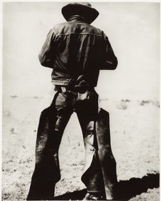 Rear view of a man wearing chaps and spurs