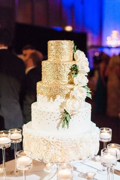 Glamorous five tier wedding gold glittered and rose embellished wedding cake: http://www.stylemepretty.com/georgia-weddings/savannah/2016/09/12/a-traditional-southern-cathedral-wedding-bathed-in-blue/ Photography: The Happy Bloom - http://www.thehappybloom.com/