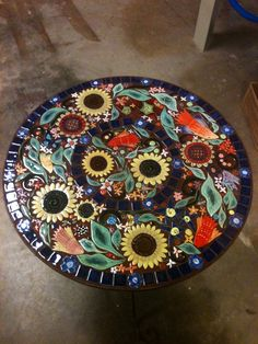A cheery sunflower mosaic table with handmade mosaic tile created by one of @Sondra Santangelo Theresa Tile Works students