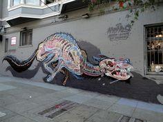 Urban street art graffiti mural by Nychos on Haight Asbury in San Francisco, Ca
