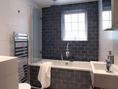 look how the glass 'shower door' folds out of the way when it's not being used.  Love it!