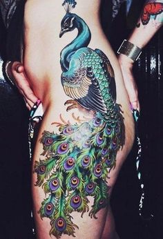 Beautiful cool peacock feather tattoo pictures, designs and meanings for females and males. Colorful images of peacock tattoos on arm, shoulder and back. #backsidetattooswomen #tattoosbackside