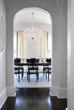 TRI Traci Rhoads Interiors - dining rooms - arched doorway, espresso hardwood floors, gray geometric rug <3