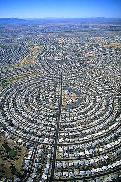 Aerial photo of Sun City, AZ. Retirement community built by Del Webb, west of Phoenix. One must be 55 to live here. Sun City Az, Sun City West, Sun City Arizona, Phoenix Arizona, Futuristic Architecture, Amazing Architecture, Urban Landscape, Landscape Design, City Skylines Game