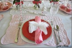 Cupid's wings napkin rings ~ sweet!  GET YOUR CUPID FEATHER WINGS HERE : http://www.featherplace.com/ic/fp/item/O5CMG/Angel-Wing-Ornament-5.html