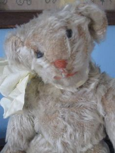 Antique American  8.5 White Mohair Bear named Nougatine. . He is an early, fluffy morsel with rust wool embroidered nose and mouth and 5 claws per