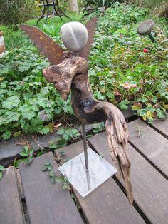 the dancer seems to be resting. the dancer seems to be resting. Driftwood Planters, Driftwood Projects, Driftwood Sculpture, Driftwood Art, Garden Sculpture, Diy Projects, Wood Slice Crafts, Garden Angels, Angel Crafts