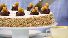 This hazelnut dacquoise recipe appears as the technical challenge in the Pastry episode of Season 2 of The Great British Baking Show on PBS Food.