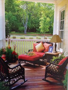Like the way the red seat covers being a warm feeling to this outdoor entertaining area. Would be cool to see the same photo with the background trees in the Fall finery