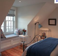 Dormer window seat in loft bedroom, could have storage under seat.
