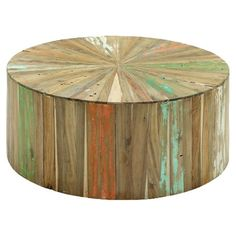 Pairing natural appeal with a contemporary silhouette, this reclaimed wood coffee table offers a fresh take on boho-chic style.   Pr...