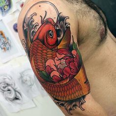 Cool Colorful Guys Arm Tattoo Of Japanese Koi Fish