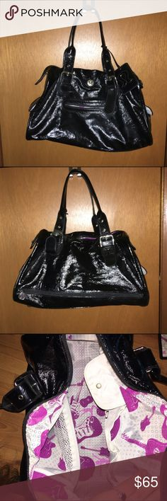 Lululemon podium duffle bag Black duffle bag by Lululemon. Gently used and smoke free. Minor wear on one spot hardly noticeable and minor wear on feet. Super cute patent leather look to it with lots of room and compartments inside and outside! lululemon athletica Bags Travel Bags