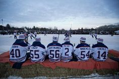 Edmonton Oilers sit on bales of hay as they wait their turn to...Not an Oilers fan but this is cool!