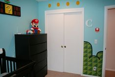 Super Mario Bros. kids rooms...I like the coins above the doors.
