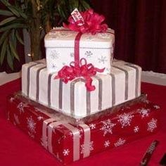 This three tier christmas gift box cake is made to look like a christmas present wedding cake. It's a red, white and silver wedding cake perfect for a christmas wedding. From Manassas Cakery      ........   #wedding #cake #birthday