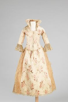 1885 This is an elaborate evening dress made for a child.  It is unusual to see a fully boned and fitted bodice made in this small of a size, possibly for a six to eight year old. It is very possible that the fabric of this dress may have come from a women's dress for a special party
