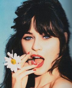 Zooey Deschanel has the best fringe on the planet! and such big blue eyes