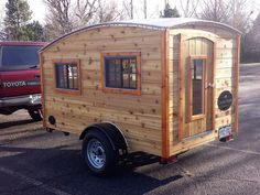 This Tiny Trailer Camper might not be a teardrop but I think it is awesome