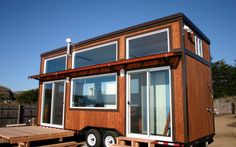 These Tiny homes wonderfully illustrate a mission to use less, waste less and live more with great designs for living life.  http://www.tinyhousewebsites.com
