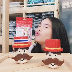 "Here is Chacha Rita Ramnarong (http://instagram.com/chacharitaa), a popular Thai actress and singer posing with my designs of the nanoblock versions of Mr. Trumpet character from her fashion brand ""Sugar Moustache"" (http://www.sugarmoustache)"