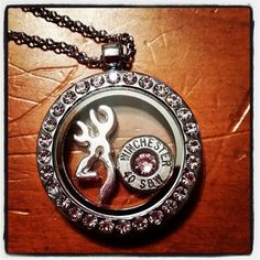 The 2 charm locket comes on a 18 in Rhodium chain. YOU CAN ADD AN INITAL PUT IT IN NOTES TO SELLER AT CHECKOUT  **Caliber and Size will vary