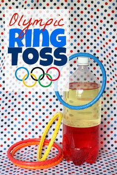 """With a little imagination, simple diving rings can be transformed into an Olympic event! Here's what you'll need: diving rings; a 2-liter bottle filled with water, sand, or any other liquid (I used one filled with oil and water from our """"Make Your Own Lava Lamp"""" post); and masking tape.  *Even if you don't have"""