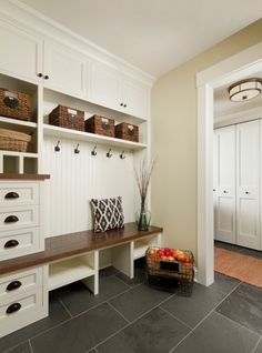 large entryway, love the built-in drawers and shelves and cubbies with the wood bench | 100+ Beautiful Mudrooms and Entryways at Remodelaholic.com