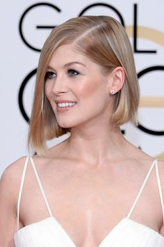 "Rosamund Pike looked uh-mazing with a razor-sharp asymmetric cut. ""I just gave Rosamund an asymmetrical bob with a secret undercut in the back. It enables her to wear her bob in many different ways."" says hairstylist Kylee Rae Heath. She finished off the look with gorge natural makeup. -Sugarscape.com"