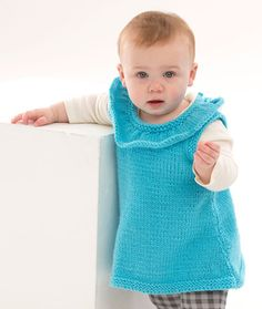 Rockin' Ruffles Baby Tunic Free Knitting Pattern from Red Heart Yarns - Perfect to wear over fashion leggings, baby will look adorable in this ruffled knitted tunic. This yarn has been tested and certified free from harmful levels of over 300 substances. Look for the tested mark with the blue heart on the ball band.
