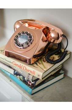This corded phone has a chic '60s silhouette. The push buttons update the rotary dial, while the gleaming copper hue mixes well with contemporary décor.