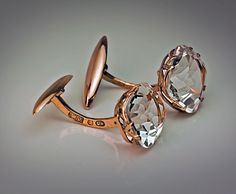 A pair of antique 14 K gold cufflinks set with two sparkling cushion cut rock crystals. Made in Kiev between 1908 and 1917.