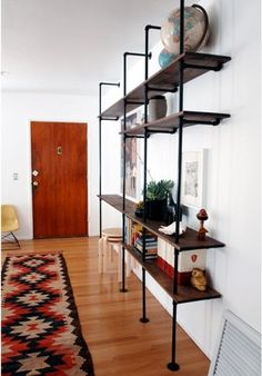 Morgan's DIY Plumbing Pipe Shelving | Apartment Therapy think this for living room with wood floors. Save wood wall for sunroom. See post for bar:)