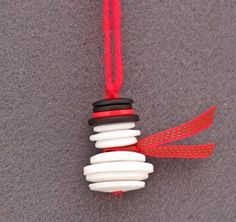 Easy Christmas Craft: Button and Yarn Snowman - Includes instructions with button sizes needed.