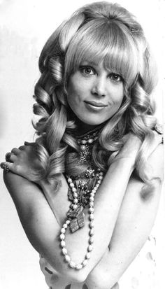 Pattie Boyd was the face of the '60s. Her blonde hair, deep bangs, long legs, and perfect pout got her on magazine covers and snared her a b...