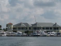 Naples Sailing And Yacht Club, beautifully situated on the waterfront with views of Naples Bay!