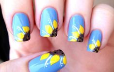 15 Sunflower Nail Designs for Summer and Beyond - http://slodive.com/nails-2/15-sunflower-nail-designs-for-summer-and-beyond/