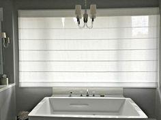 This roman shade creates a modern effortless look while providing privacy in the master bath.  #romanshades #masterbath