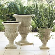 Outdoor planters are pretty even if you don't have a green thumb (like me).  They attract the eye to an empty front porch, patio, even a deserted driveway can use an accessory sometimes!