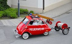 By Michael Banovsky.  BMW Isetta fire truck.    What better way to get to the scene of an emergency than with a small city car? Problem is, you're going to have to politely ask the neighbours for water once you get there…